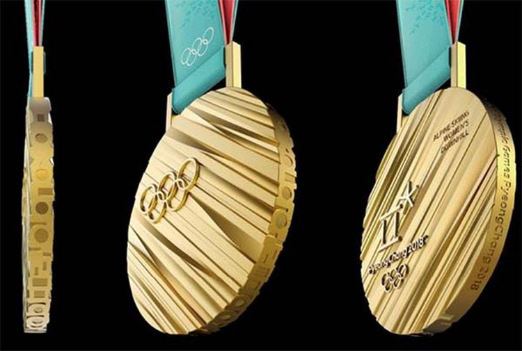 Here's a First Look at the XXIII Olympic Winter Games Gold Medal; Can You Guess What It's Worth?